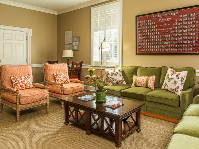 Pi Beta Phi Sorority House 8 Family room olive orange dark wood and glass coffee table light wood spindle chairs Pebbles Nix Interiors