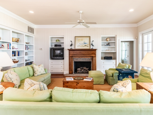 Prince George at Pawley's Island 23 family room fireplace mint green Pebbles Nix Interiors